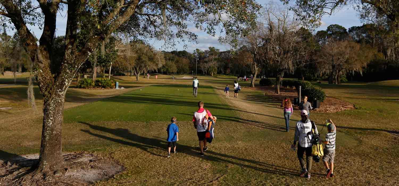 golfers-walking-on-course