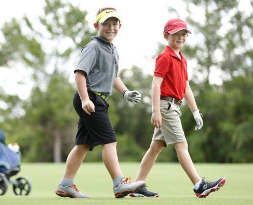 2 boys playing golf