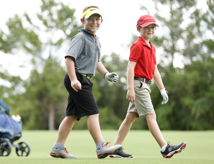 2 boys playing golf