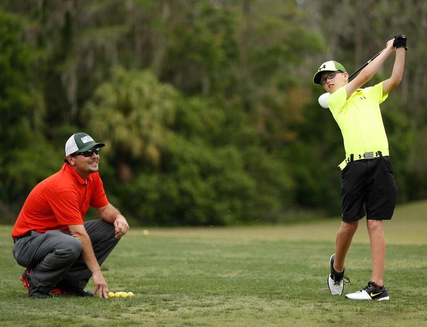 golf lesson on range