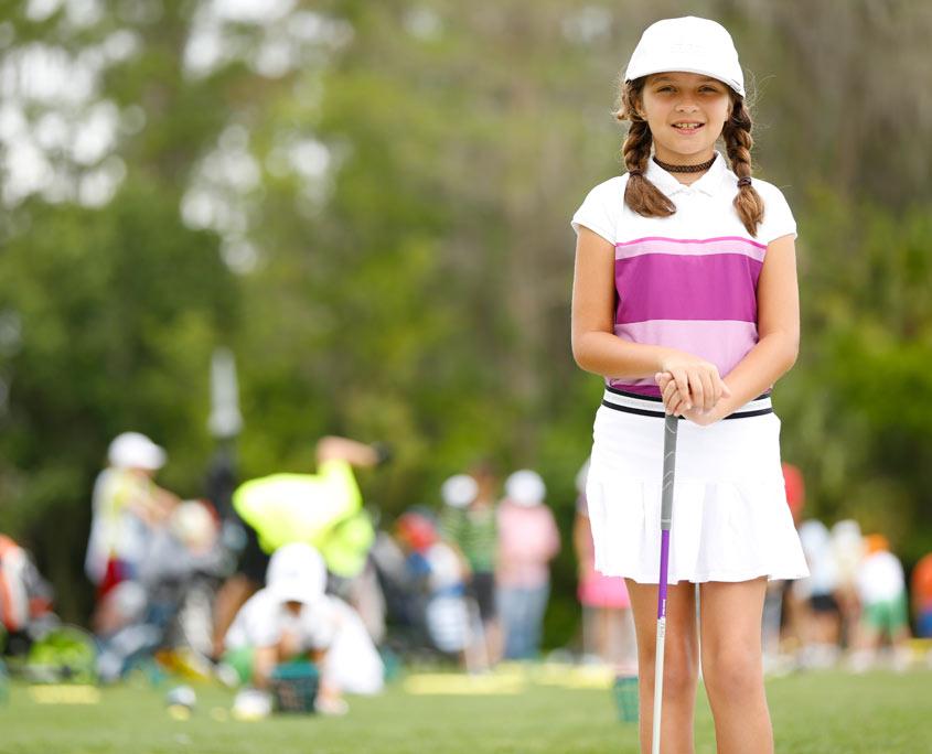 academy-golf-student-girl-on-range