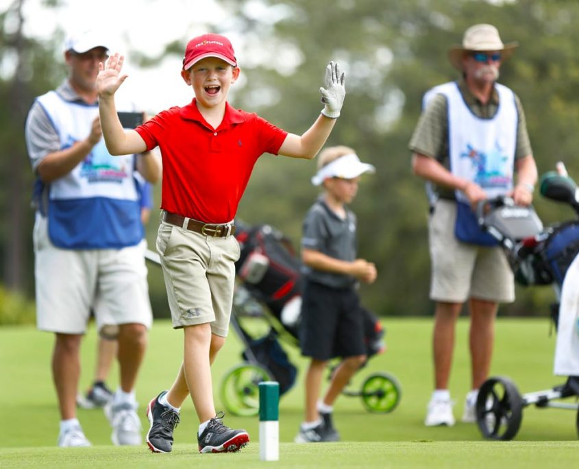 junior-golfer-celebrating-good-shot