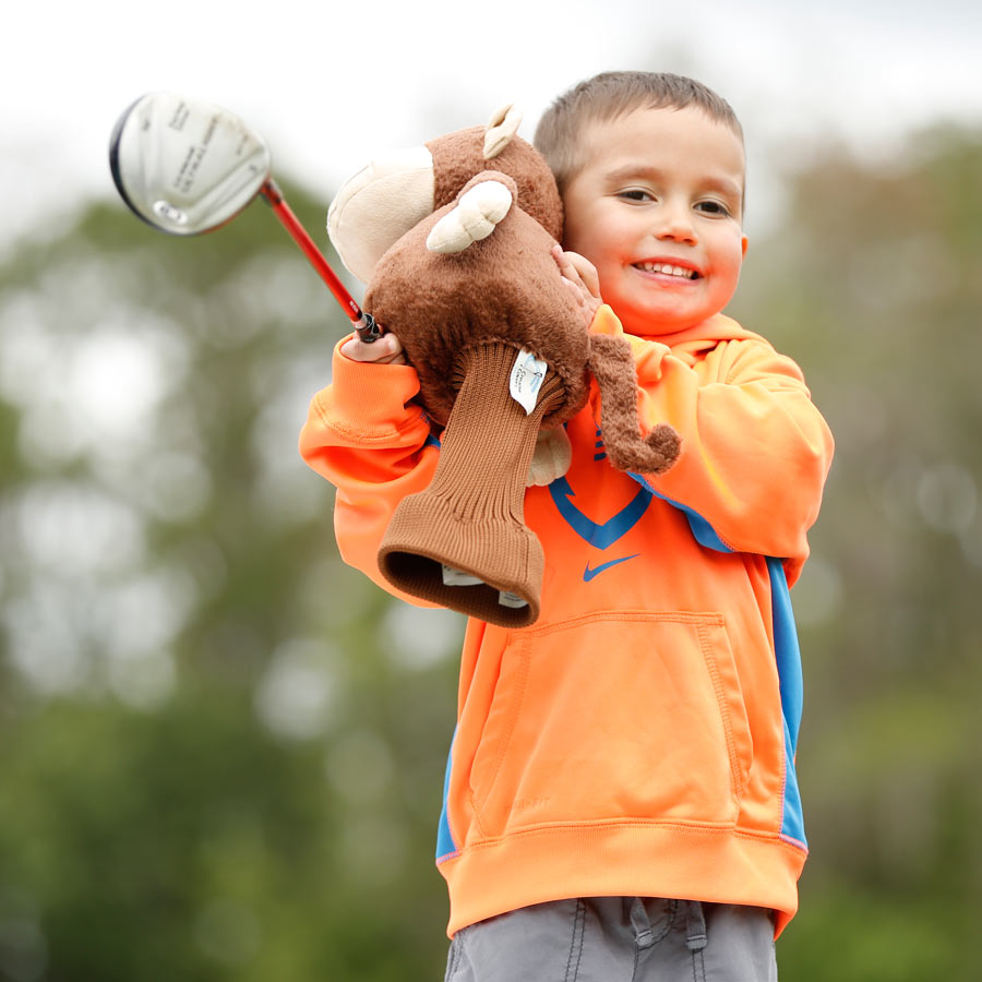 boy-with-golf-headcover