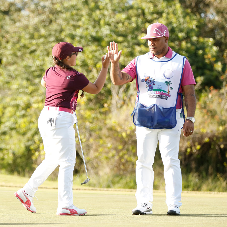 girl-golfer-high-fiving-dad