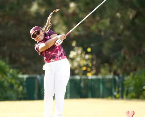 girl-golfer-teeing-off