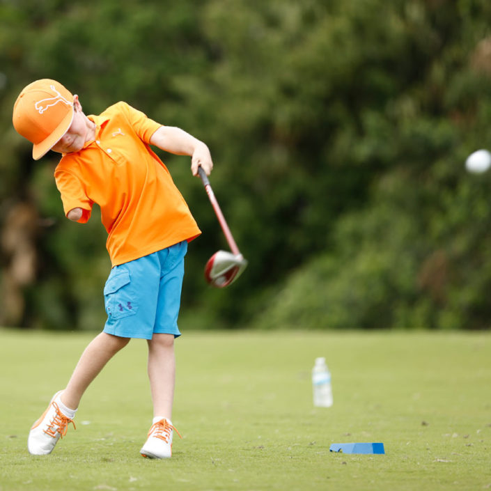 golfer-in-orange-shirt