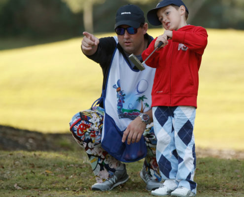 kid-golfer-and-coach